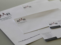 Business collateral designed for Red Mountain Resources, including letterhead, a business card, and envelopes