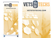 A banner stand created for VetsToTechs for the company's kiosk at a job training event