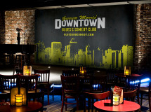 A branded stage backdrop created by The Remedy used in Garrett Morris' Downtown Blues & Comedy Club's new venue